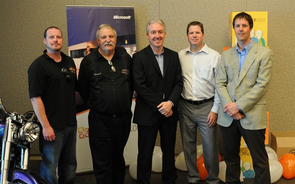 L-R: Steve Clifford - Service Manager, Jacox Harley-Davidson; Marshall Horner - GM/Partner, Jacox Harley-Davidson; Eric Gales - President, Microsoft Canada; Peter Mackenzie - VP Sales & Marketing, Envision IT; Peter Carson - President, Envision IT